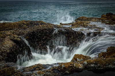 Thor's Well as wave recedes