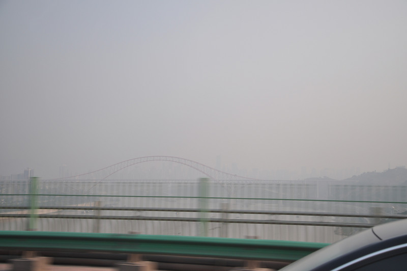 There is more skyline there, barely visible through the haze beyond the bridge.  The haze isn't pollution -- it's humidity.  This part of China is practically jungle...it's a lot like southern Florida in climate.