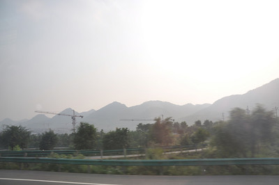 ...and getting toward the end of skyline, at least along this highway.  The Chongqing area is also rather mountainous, with steep-sided hills all over the place (probably a function of weathering in the humid climate).  The hills, of course, are covered in lush forests.  But for all I know, the skyline continues on the other side of these hills!