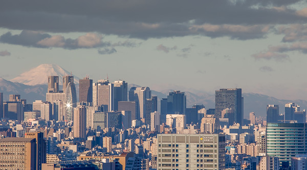 Good Moring Tokyo! View from my window towards Shinjuku and the mount  Fuji. In winter the lower sun is reflected in the windows of the Mode Gakuen Cocon Tower for an instant. HDR from three handheld exposures