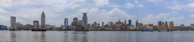 Shanghai. View to the Bund from the Pundong side of Huangpu river. Mid July 2015 it was very hot and the water level was over the banks. Panorama fused from 7 hand held shots.