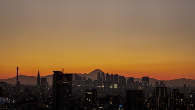 Winter sunset over Tokyo with Fuji san. At first I fused 10 portrait format sets of 3 pics each with different exposures (-2/0/+2) which I subsequently stitched into one panorama. No other picture maniputlation.