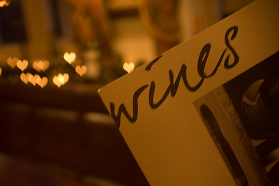 I Heart Wines  I've just read up on custom shaped bokeh, and thought I'd give it a go in the local pub.  He're me getting arty with the menu and the Christmas lights in the background