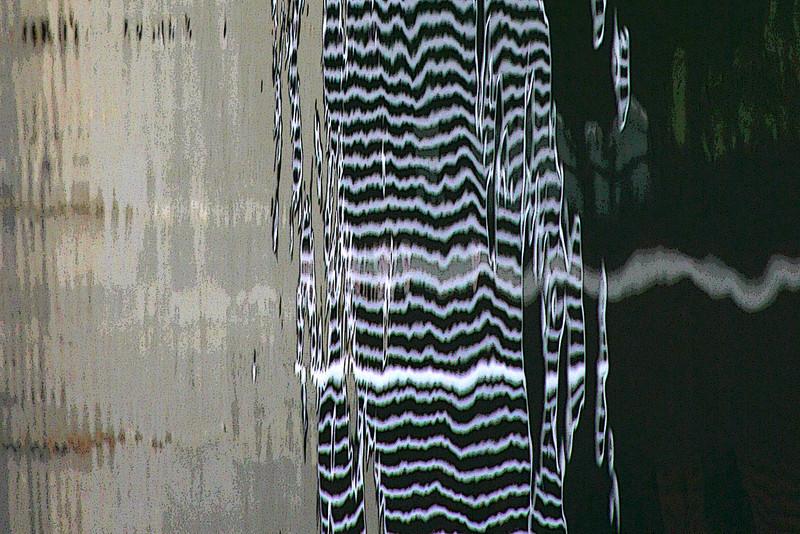 Reflection of railing along harbor, Marina del Rey, texture effect.