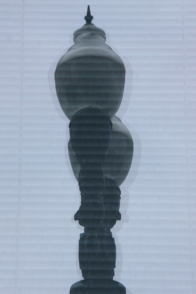 Lamppost reflected in a window, with venetian blinds, downtown San Diego