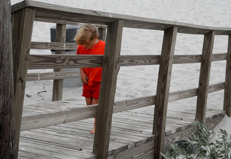 kid on boardwalk
