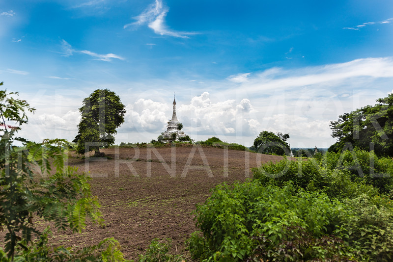 Painted Brick Stupa on a Hill