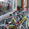 Colourful bikes wait for riders on a Vancouver street