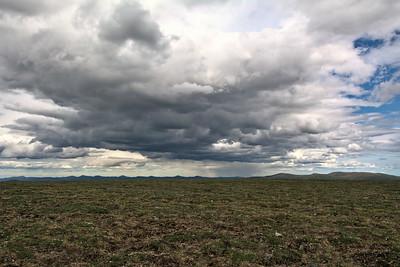 Plains, Clouds, and Rain