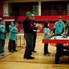 Notice the anticipation on all the MASH team members as they participate in the board competition.  Look on the left side of the picture...see Timothy?  <br /> <br /> The Lego Robotics competition includes robot design and programming, as well as special a special research project/presentation and a teamwork exercise.