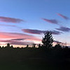 Panorama of the sunset over our side pasture--taken with my iPhone 4 and stitched with an on-phone app.