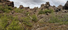 Dimmuborgir panorama.  A volcanic area just east of Lake Myvatn.<br /> <br /> One of the enclosed valleys.<br /> <br /> This is an area of exposed lava pillar steam vents.  The pillars or chimneys formed in a large lava lake when steam bubbles burst up through the liquid lava, and the surrounding lava cooled and hardened into the chimney vents.  Subsequently the remaining liquid lava drained away and left the free standing chimneys.  This is the only place on each where such formations exist above water.  Walking through these 'dark castles' is an unforgettable experience.<br /> <br /> Stitched from 4 hand-held portrait format singles, shot using manual exposure at 32 mm.