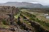 Looking down the main fault, crevasse, or rift at þingvellir, Almannagjá.  The distant flagpole marks the historic Lögberg (Law Rock).<br /> <br /> þingvellir National Park, Iceland.