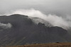 Hills (or low mountains) veiled in morning mist.<br /> <br /> Western Iceland.