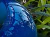 Detail of blue vase.<br /> <br /> Dale Chihuly, artist.<br /> <br /> Conservatory, Frederik Meijer Gardens and Sculpture Park,<br /> Grand Rapids, Michigan.<br /> October 7, 2010.