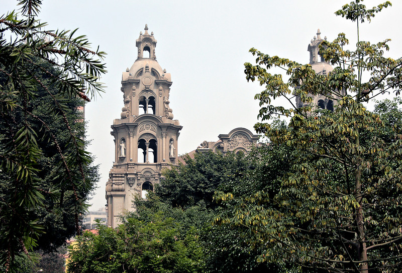 Lima, Peru<br /> <br /> The Miraflores district of Lima is full of verdant parks and churches, many in the colonial style of architecture even if they were built later.  This picture illustrates both of these features.