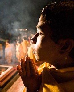 A young resident of the Parmarth Niketan Ashram participating in the nightly Ganga Aarti ceremony