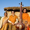 Women with a sitar at the M.C. Mehta Environmental Foundation in Medawala, India