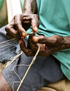Repairing a fishing net, Cape Coast, Ghana