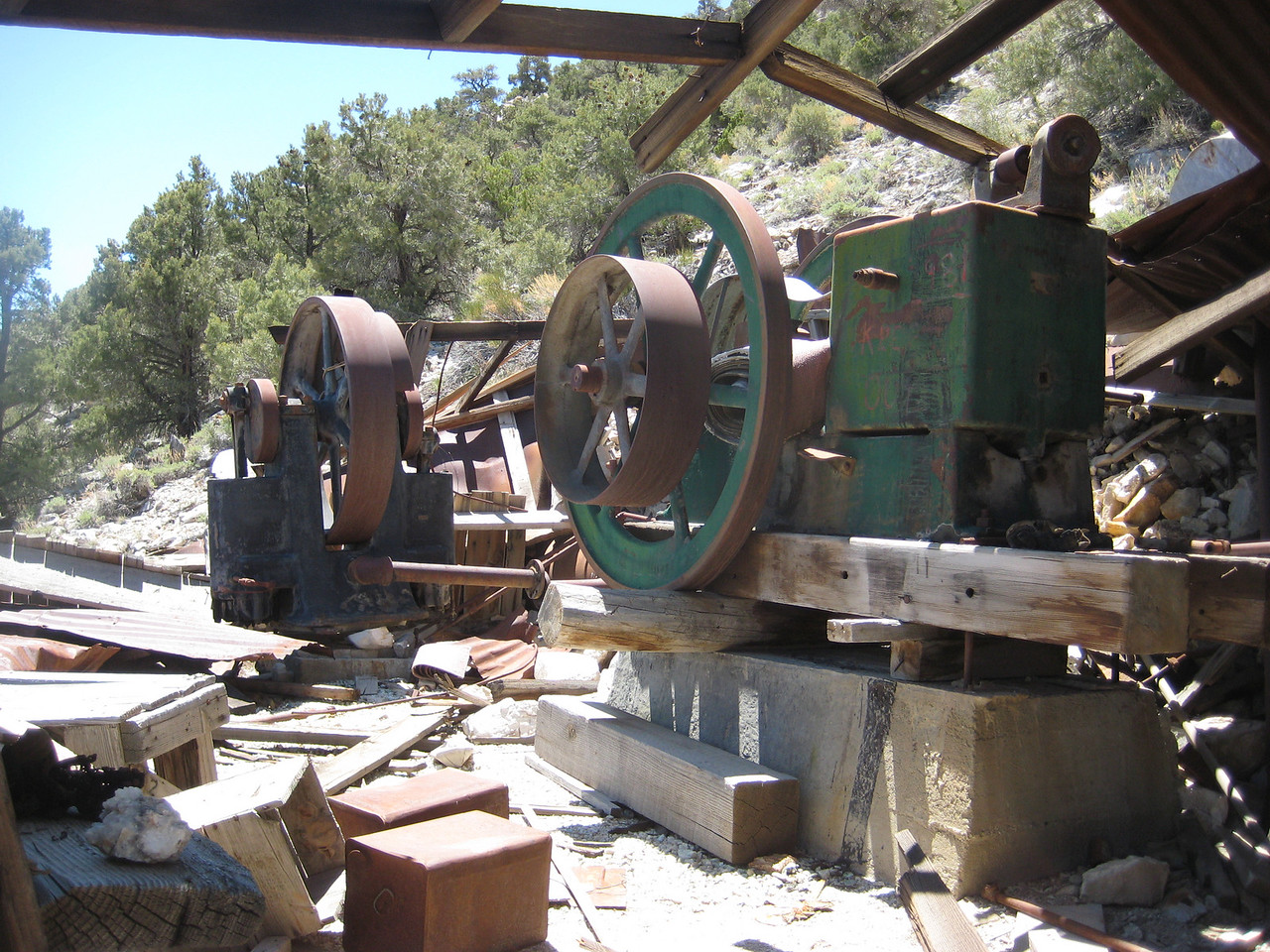 Air compressor and Steam engine for running the belts and providing air inside the mines and tools.