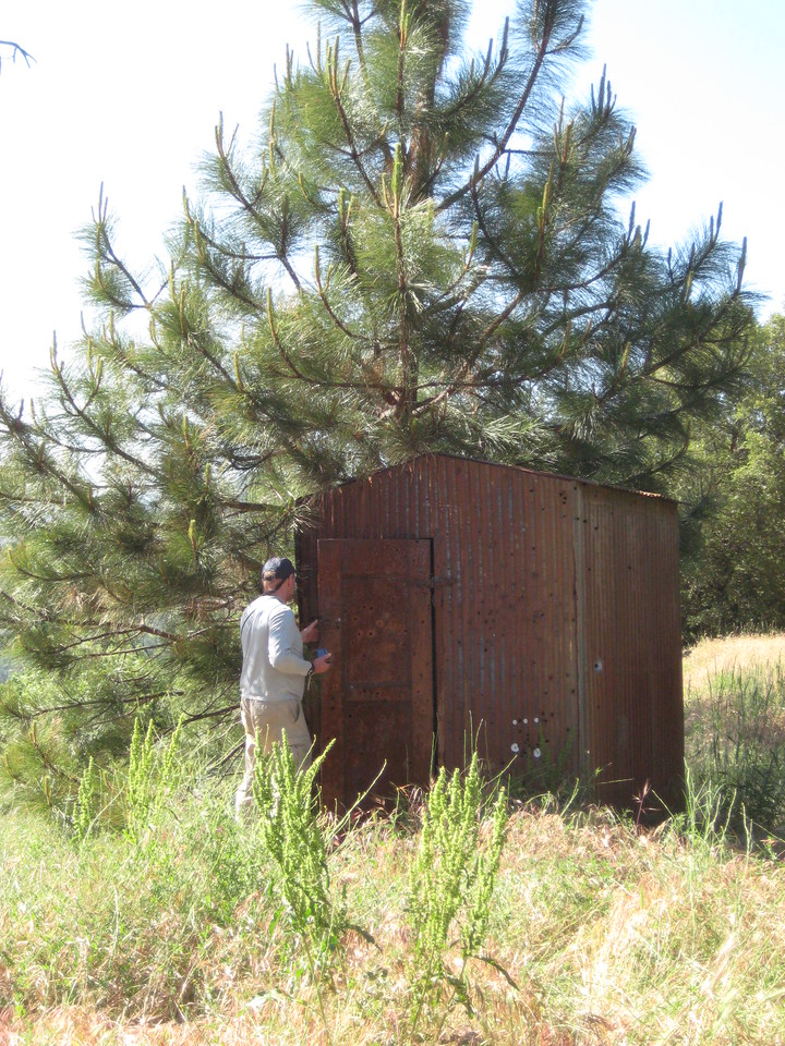 Tim checking out the outhouse.