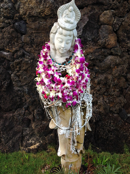 Leis on the garden deity