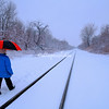 Walking along the railway lines in a snow storm