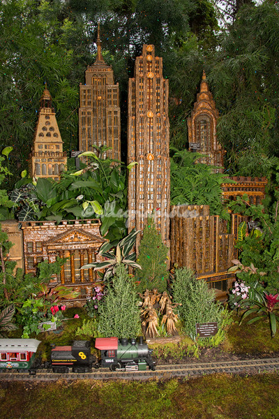 A model train passes in front of iconic New York City buildings, part of the New York Botanical Garden's annual Christmas train show.