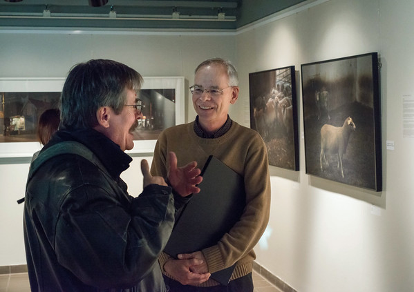 "Richard Perron at his ""II [DIS] - APPEAR"" photo exhibition at the Atrium gallery at Ben Franklin Place in Ottawa, Ontario, March 24, 2014.  Photo by Garth Gullekson. Avec Robert Laramée"