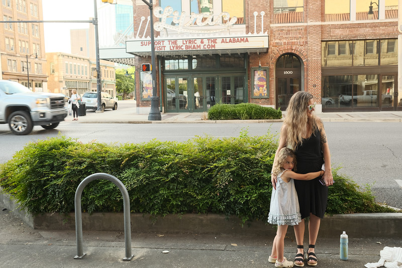 willow and mom in front of the alabama theatre and the lyric