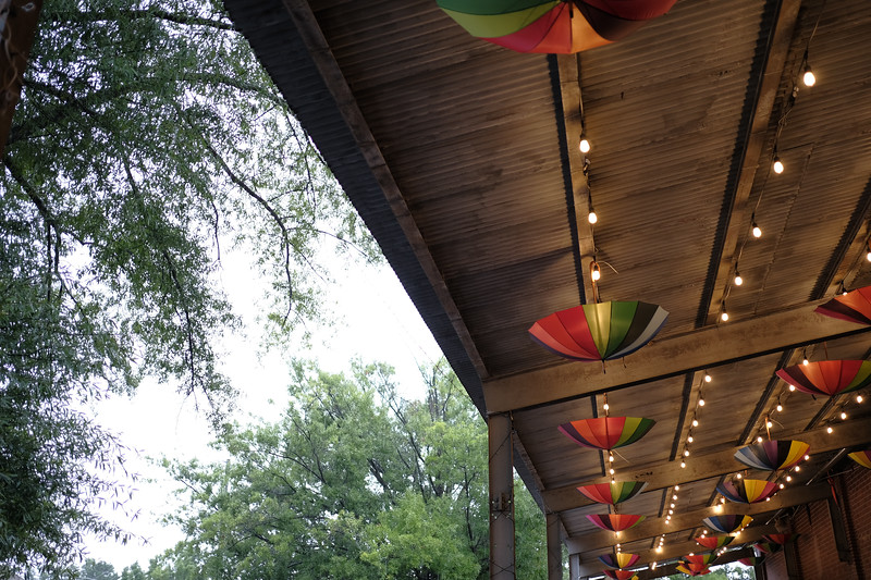 creative way to address a leaky roof - umbrellas at cahaba brewery