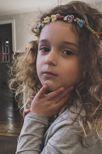 portrait of hippy willow wearing her flower bead necklace as a headband