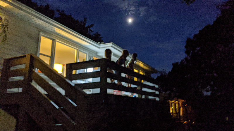 "willow, addi, and lyla on the front porch of our new house, looking at the moon and ""jupiter"" ?"