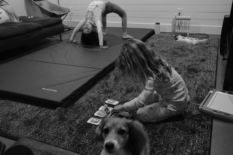 lyla practicing gymnastics, willow setting up the puzzle, and annie staring at me