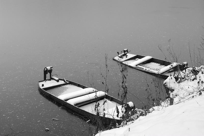 Boats at a frozen lake