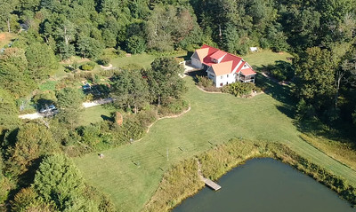 Overlooks the 7000 sq.ft. garden and pond
