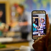 """KRISTOPHER RADDER - BRATTLEBORO REFORMER<br /> People take video footage while Hinsdale High School student Kelsi Clement examines a dog during her Extended Learning Opportunities' presentation """"Vet Clinic/Behind Closed Doors,"""" on Friday, May 18, 2018."""