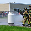 """KRISTOPHER RADDER - BRATTLEBORO REFORMER<br /> Hinsdale High School students Tori and Zach Gassett with the help from Hinsdale Fire Department spray water on a propane tank during a simulation of a gas leak as part of their Extended Learning Opportunities' presentation """"We've Got Gas,"""" on Friday, May 18, 2018."""