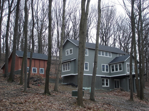 With a little imagination, this wooded lot accommodates a large detached garage and storage building.