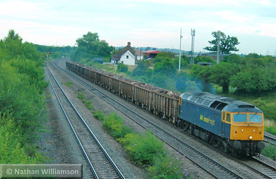 57006 heads west through Magor on the: 6V95 10:22 Stockton to Cardiff Tidal  06/07/09