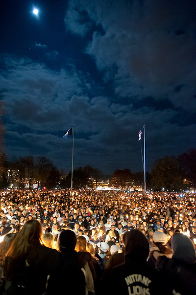 Thousands gather outside Penn State's Old Main administration building on Friday, Nov. 11, 2011, during a student-organized candlelight vigil planned to show Penn State student support for child sexual abuse during the ongoing abuse investigation of former assistant football coach Jerry Sandusky. The event drew as many as 10,000, according to unofficial police estimates. Photo by Andy Colwell