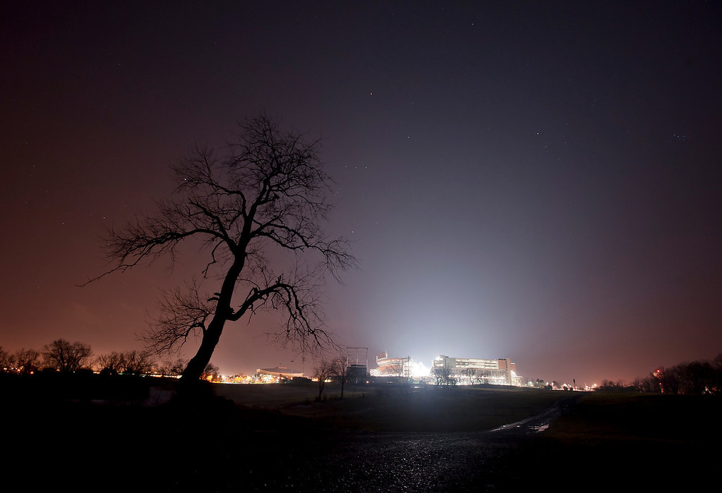 Penn State's Beaver Stadium glows early in the morning of Monday, Jan. 23, 2012, as Penn State mourned the death of its former head football coach Joe Paterno. Stadium staff left the facility illuminated each night for the week following the longtime coach's passing. Photo by Andy Colwell