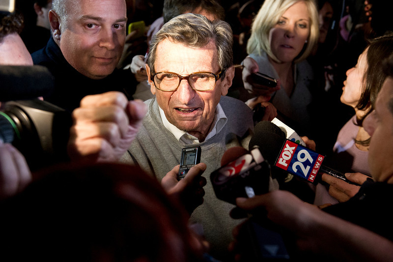 Former Penn State football head coach Joe Paterno speaks to gathered students and media outside his home in State College, Pa. Tuesday, Nov. 8, 2011, in direct response to his announcement earlier that day that he would step down as coach at the end of the 2011 season. The Penn State Board of Trustees would vote the following night that Paterno would no longer be coach, effective immediately. The board's statement also confirmed rumors that Penn State President Graham Spanier would also step down. Photo by Andy Colwell