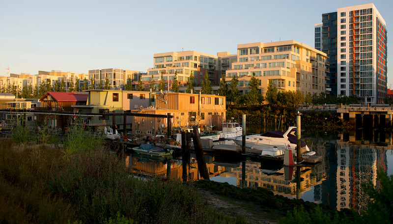 The Mission Creek Harbor houseboats of Mission Creek Channel are seen just after sunrise on Wednesay, June 6, 2012. The neighborhood has witnessed the coming and going of industry and residential development since the floating community began in the 1960s. Srnka has lived at the end of the pier for 40 years - longer than any other current resident. He says he much preferred the harbor before the new high-rise and high-tech construction flanking it today, but he vows never to leave if he has the choice.