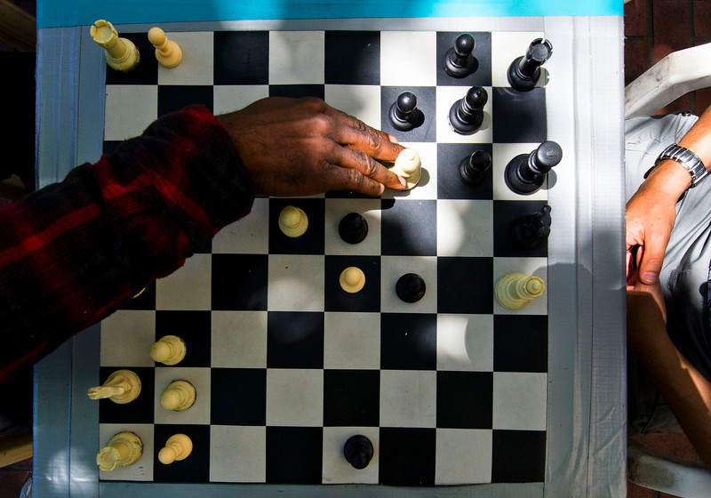 Personal vision: photograph a scene that demonstrates something in San Francisco that the photographer brought to the picture to make it his/her own.<br /> <br /> Chris Davis, 40, left, of San Francisco's Haight neighborhood, plays chess with Ricardo Concha, 27, right, who is visiting from Santiago, Chile, as they and others play chess along the 900 block of Market Street in San Francisco on Wednesday, June 6, 2012.