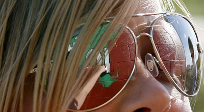 The reflection of Stew-Stras senior Shiloh Vonderheide is seen in her sunglasses as she paints the side of Gary Brehmer's barn in Stewardson, Illinois on Friday, October 3, 2008. (Jay Grabiec/Staff Photographer)