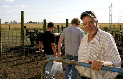 Gary Brehmer opens a gate so that Stew-Stras high school seniors can get in to paint the side of his barn in Stewardson, Illinois on Friday, October 3, 2008.  In years past the seniors would sneak in to paint the barn, but since installing electic fences, Brehmer insist that the students be let in at an arranged time.  (Jay Grabiec/Staff Photographer)