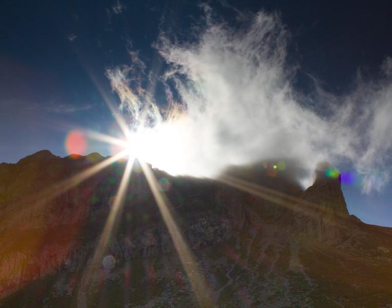 Sunburst in the Alps. Switzerland.