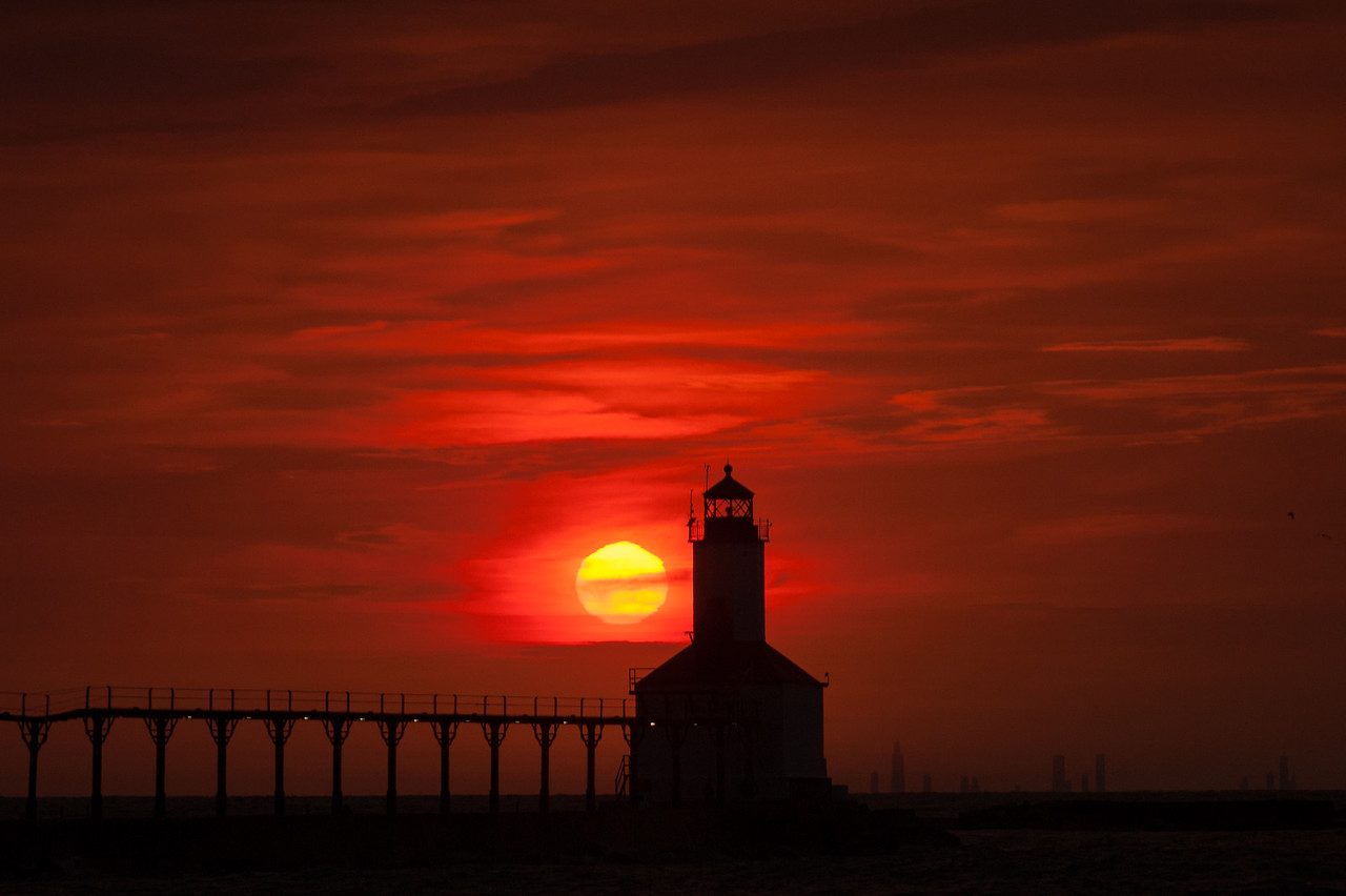 Sun Sets Next to Michigan City Light House