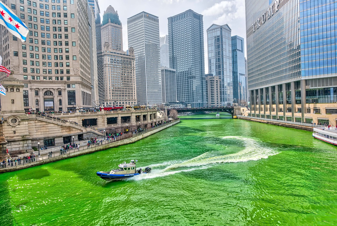 A Chicago Police Boat Speeds Through Green River on St. Pat's Day